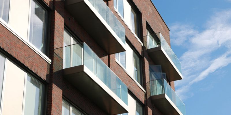 Sleek Clean lines of frameless structural glass on balconies