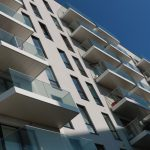 White soffits and fascias with balconies wrapping around corner