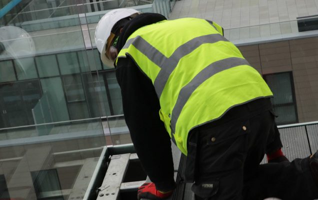 Balcony installation construction worker tightening balcony connection
