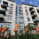 Flowers in front of Lillie Square balconies