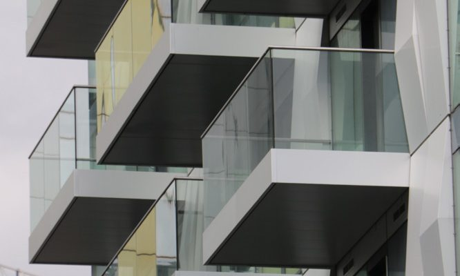 Balconies with silver anodised fascias to match unitised